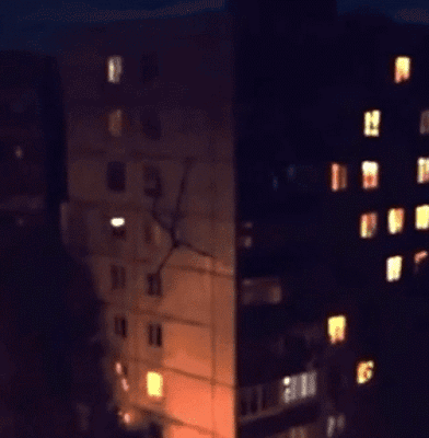 Stick-like creature seen climbing down a building in Russia