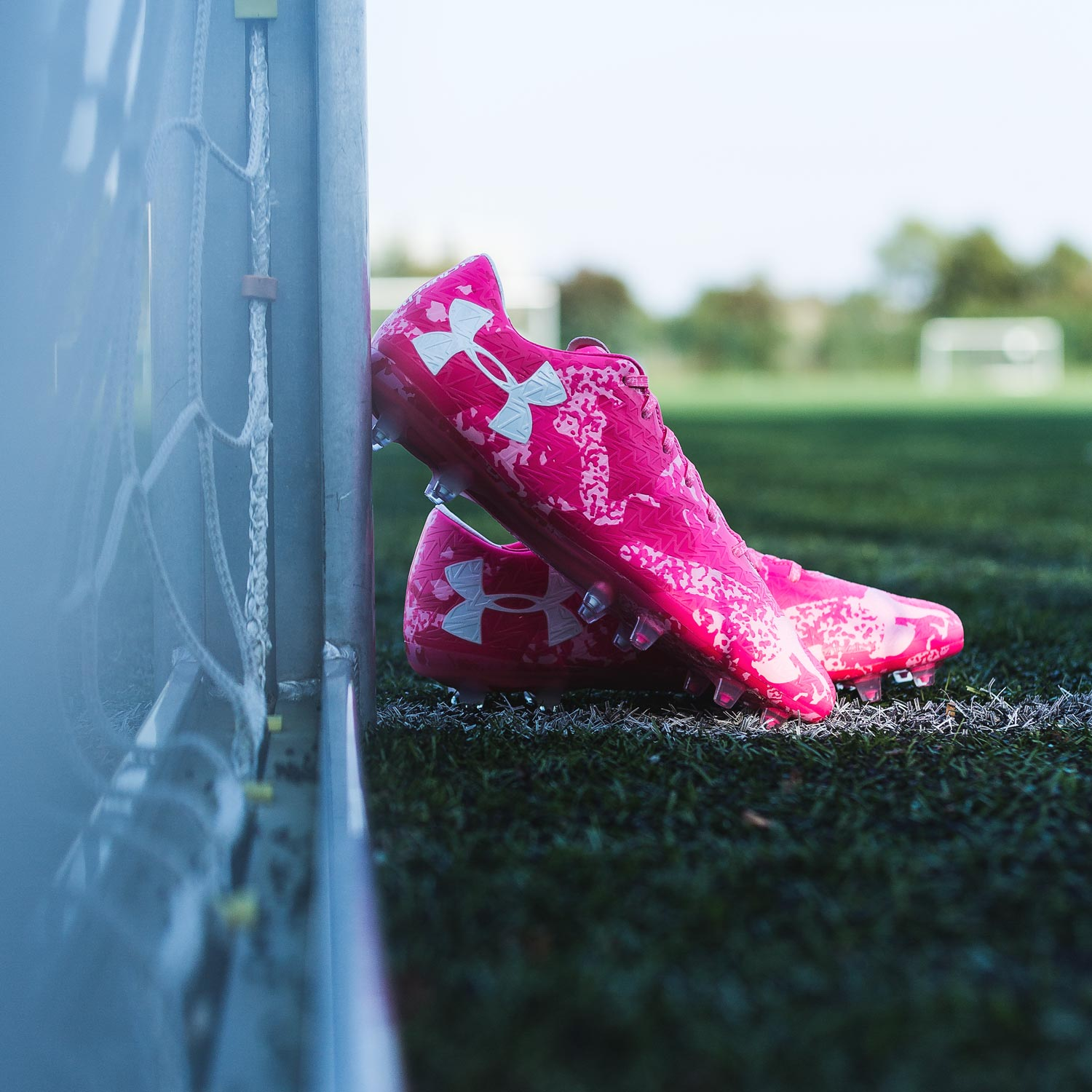 newest 5fba5 91038 ... Boasting pink colorways, both the new Under Armour Spotlight and ClutchFit  Power in Pink soccer ...