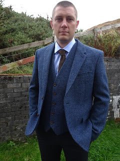 handsome man in tweed jacket and trousers