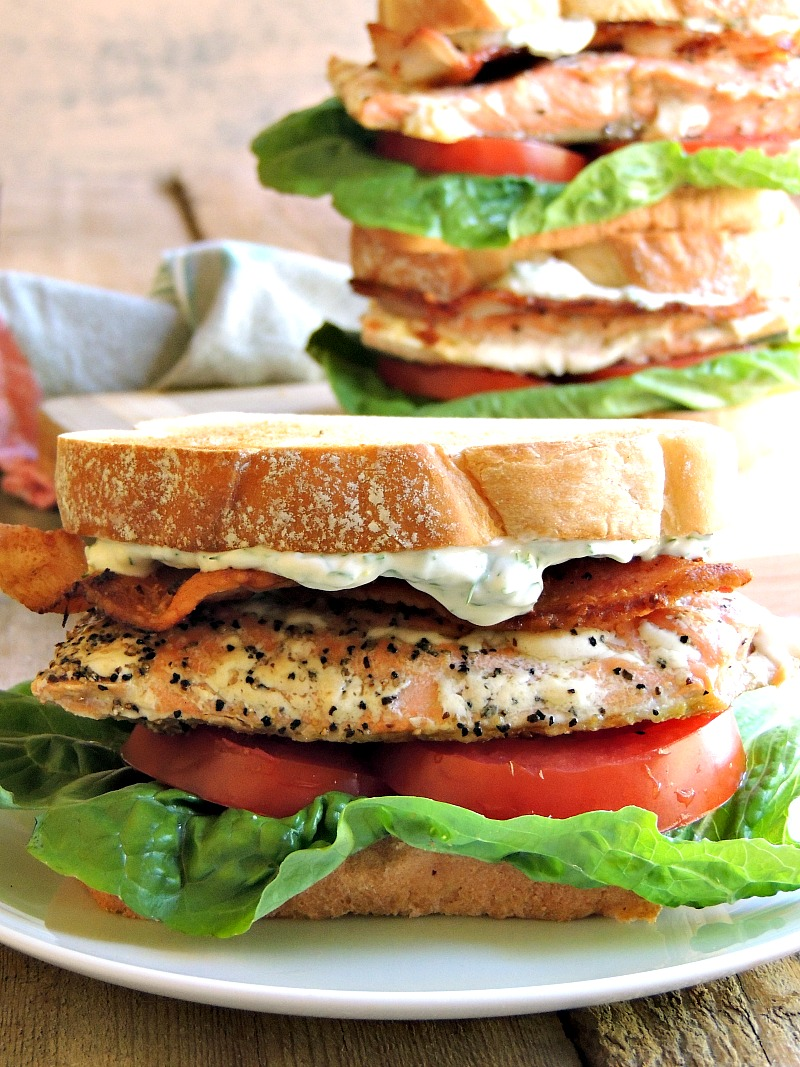 Give your BLTs an upgrade with the addition of a pan-seared salmon fillet and creamy lemon dill mayo. #salmon #fish #easy #keto #lowcarb #lchf #sandwich #recipe | bobbiskozykitchen.com