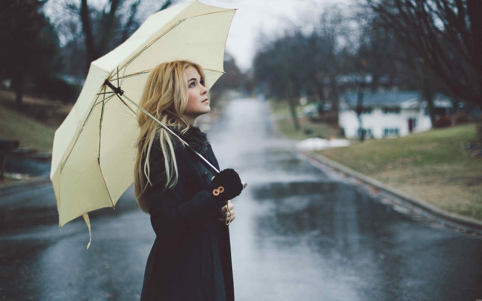 girl looking at rain whatsapp profile picture