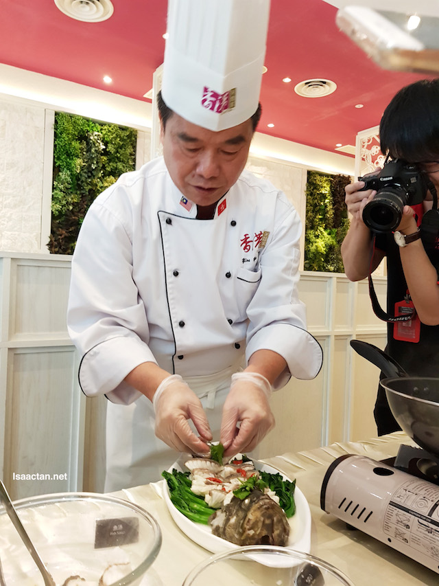 Chef Yim garnishing the garoupa