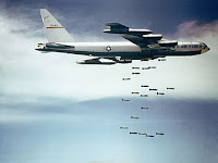 Boeing B52 dropping bombs in Vietnam. By USAF [Public domain], via Wikimedia Commons