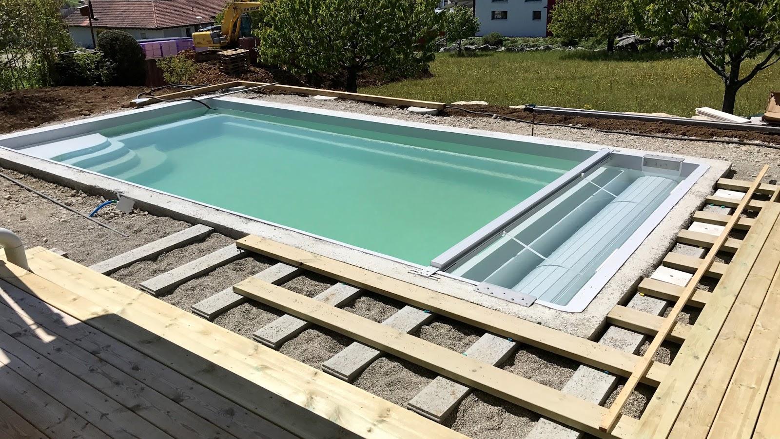 Die umgebungsarbeiten wie aus einer baustelle ein garten for Gartengestaltung um den pool