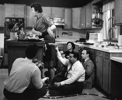Behind-the-scenes black & white photograph of Julia Child filming her cooking show