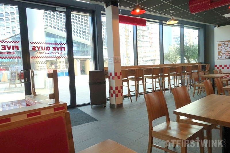 Utrecht Centraal Station Five Guys burger restaurant windows