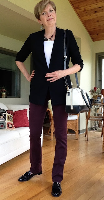 black Helmut Lang jacket, burgundy NYDJ jeans, Kate Spade bag, black Stuart Weitzman loafers.