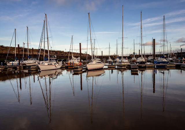 Photo of reflections in the calm water at Maryport Marina on Wednesday