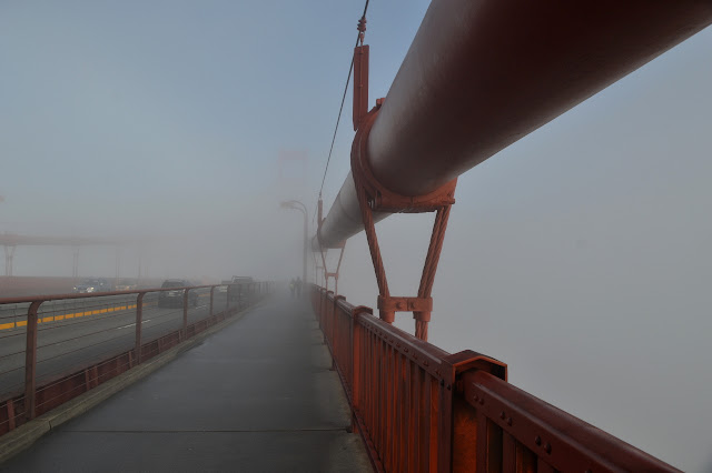 bridge vanishing in fog