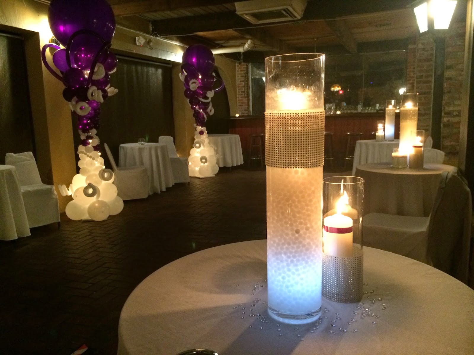 Centerpiece with candles, LED lights, gel.