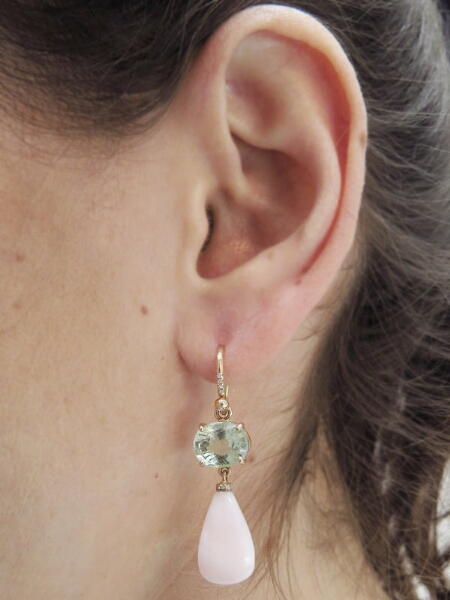 A modern look for opal, paired with tourmaline, in earrings from Ylang23