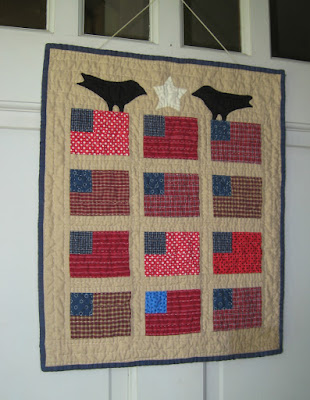 Small primitive flag quilt from a pattern by Cheri Payne