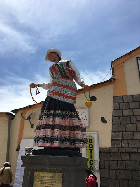 statue of woman in traditional dress in Chivay, Peru