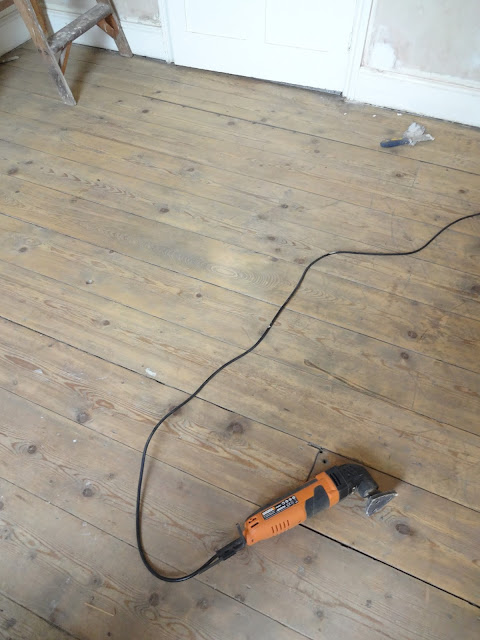 sanding floorboards by  hand
