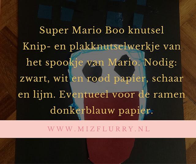 Knip- en plakknutselwerkje van het spookje van Mario. Nodig: zwart, wit en rood papier, schaar en lijm. Eventueel voor de ramen donkerblauw papier.
