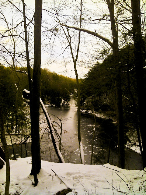 view of saugatuck river snow covered and ice forming on January first - taken from the Saugatuck trail nearest Deer Hill RD.