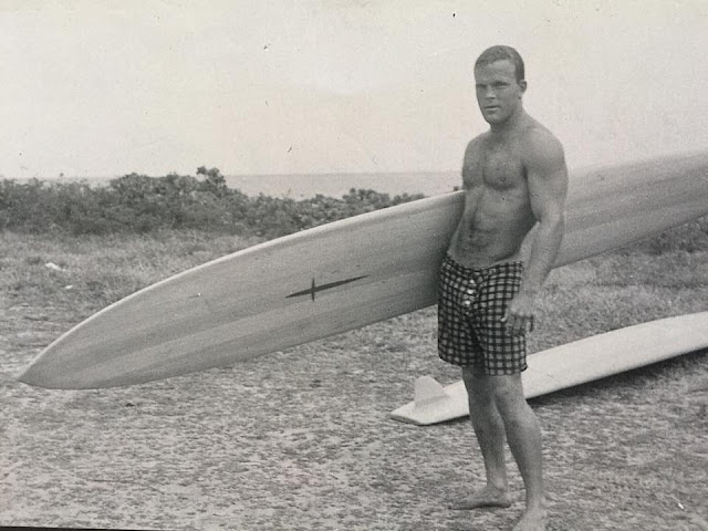 "Surfer Buzzy Trent holding a Hawaiian ""gun"" surfboard. A mans' man. Oil Upon Troubled Waters"