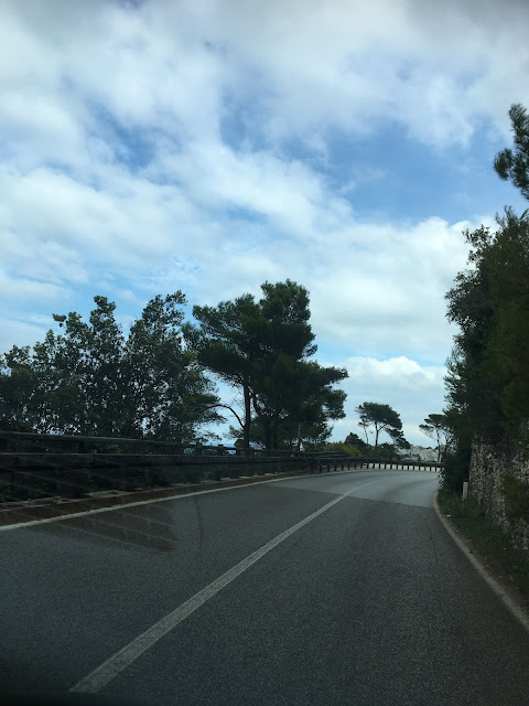 Winding ocean road into Vieste, Italy