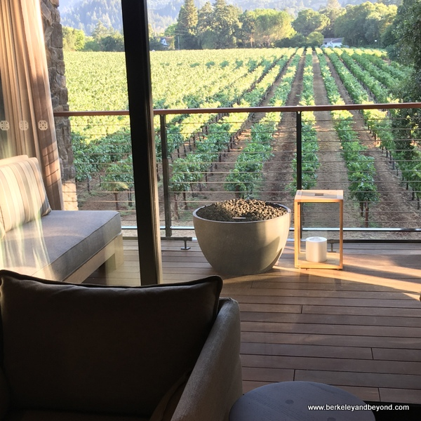 view of Beringer vineyards from guest room at Las Alcobas resort in St. Helena, California
