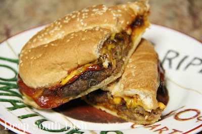 Meatloaf mix, shaped into thin, bun-sized, oval patties, pan fried and sandwiched on soft hoagie rolls with caramelized onions, cheese and a meatloaf glaze, wrapped and baked in the oven.