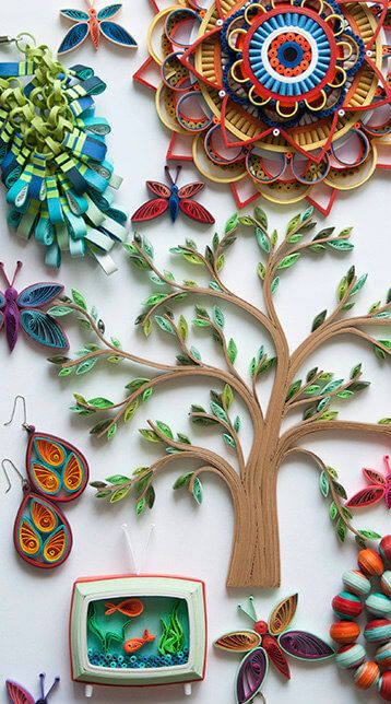 colorful quilled paper projects including a tree, mandala, jewelry, retro tv, butterflies and beads