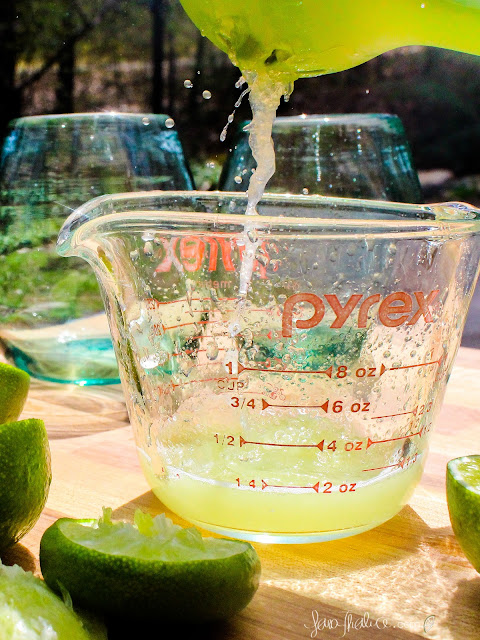 squeezing limes for margaritas