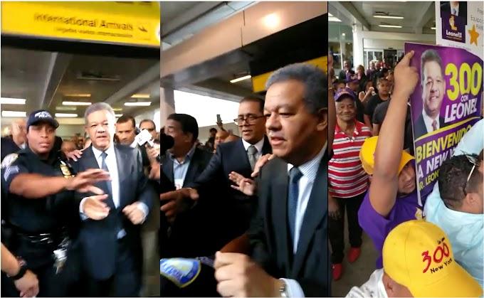 Policías impiden que Leonel saludara simpatizantes en aeropuerto de Newark donde cientos lo recibieron