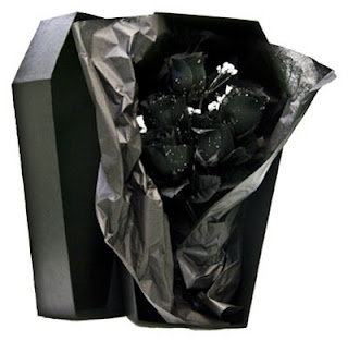 http://www.vampfangs.com/one-dozen-black-immortal-silk-roses-in-a-beautiful-black-coffin-box/