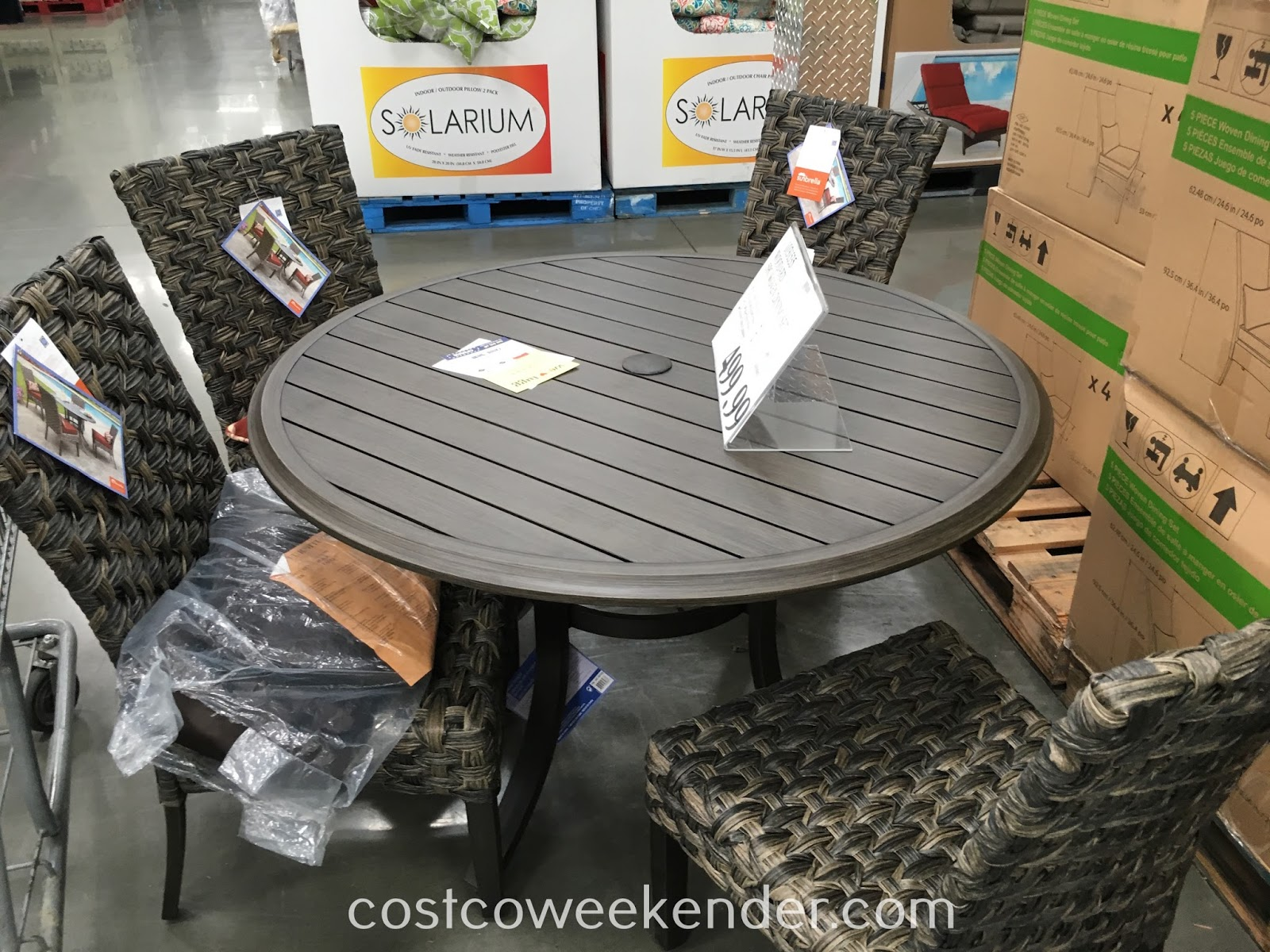 Enjoy the sun and chilling outside with the Woodard 5-piece Woven Dining Set