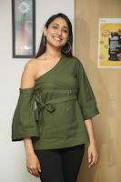 Pragya Jaiswal in a single Sleeves Off Shoulder Green Top Black Leggings promoting JJN Movie at Radio City 10.08.2017 065.JPG