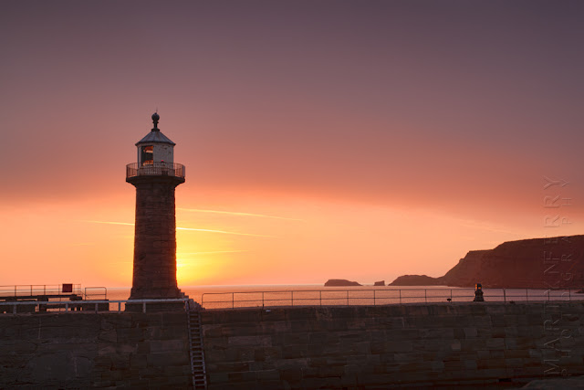 Sunrise photograph of Whitby lighthouse in North Yorkshire by Martyn Ferry Photography