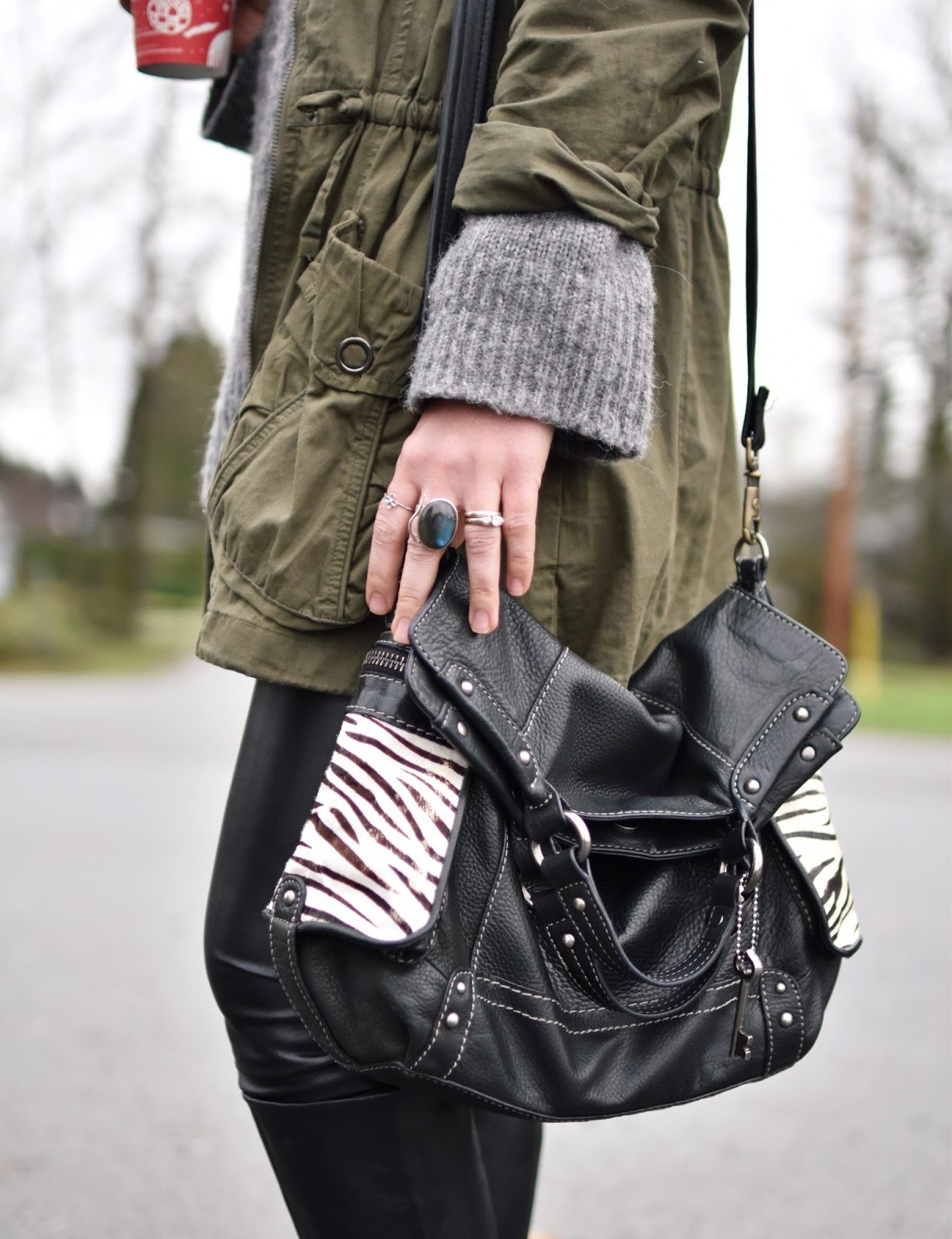 Monika Faulkner outfit inspiration - chunky wool sweater, army-style jacket, zebra-patterned Fossil bag