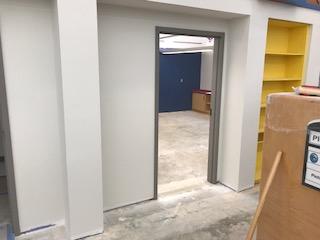 Wall with open door in it