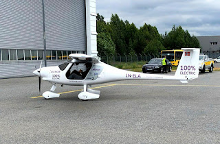 A two-seat electric plane made by Slovenian firm Pipistrel stands outside a hangar before a test flight at Oslo Airport, Norway June 18, 2018. (Credit: Reuters/Alister Doyle) Click to Enlarge.
