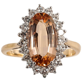 Image showing a diamond and Imperial topaz ring set in gold