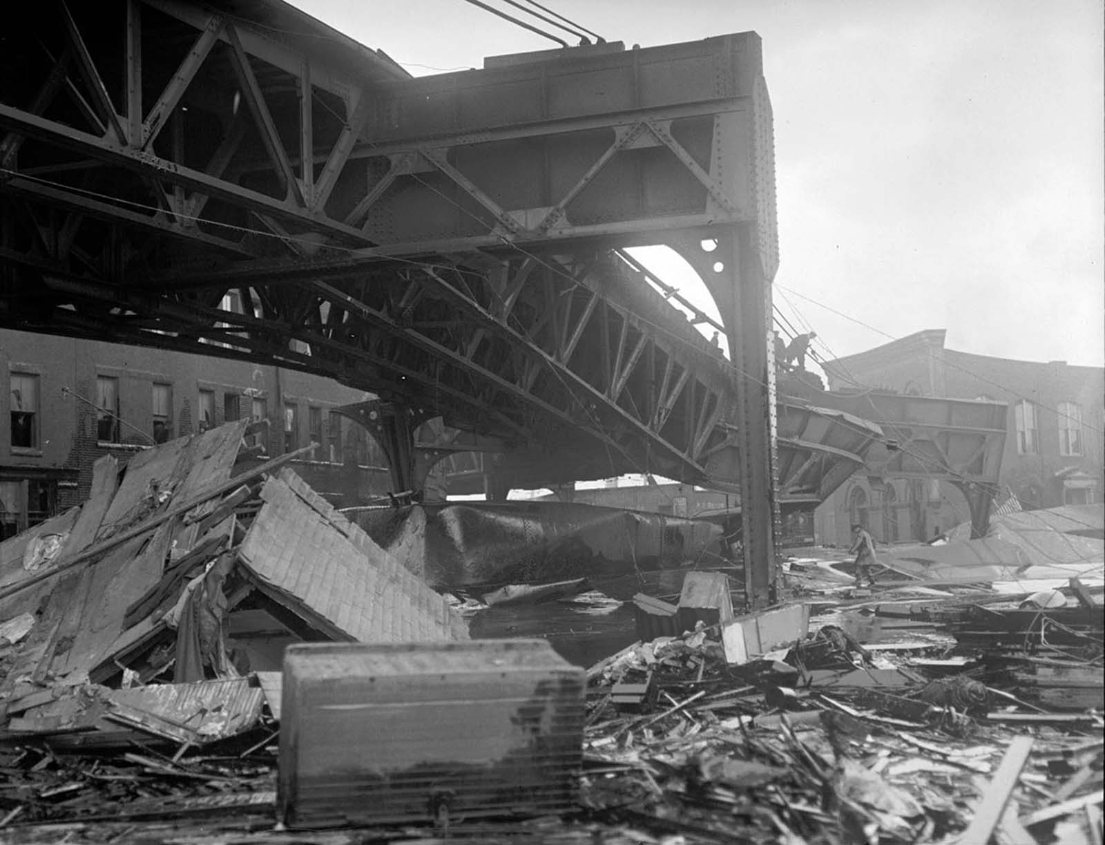 Some of the wreckage caused by the explosion of the molasses storage tank in Boston on January 15, 1919, including damage to the steel support of the elevated train bridge.
