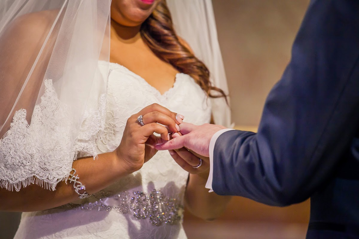 Bride and Groom Exchanging Vows And Wedding Rings