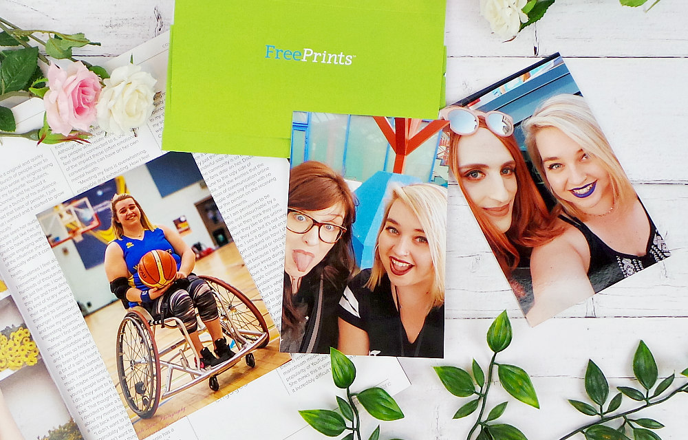 3 photos are laid out with a green free prints envelope. L-R the first photo is me in my basketball chair holding a ball. The middle is a selfie of Sarah and I, The last photo is a selfie of me and Charley