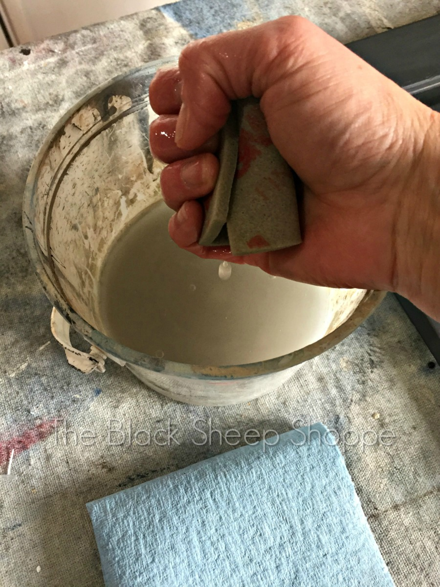 Squeeze out excess water from the sanding sponge.