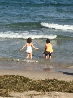 children enjoying the beach