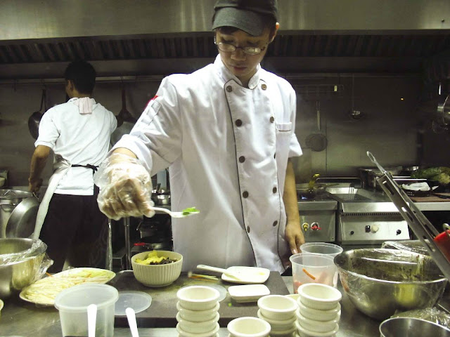 Chef preparing food inside a kitchen