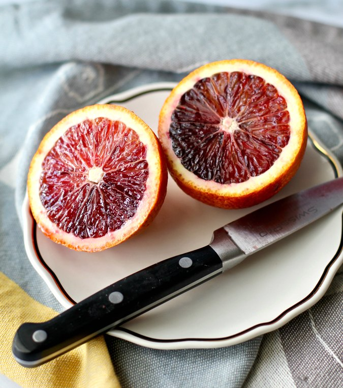 Blood oranges sliced with a knife