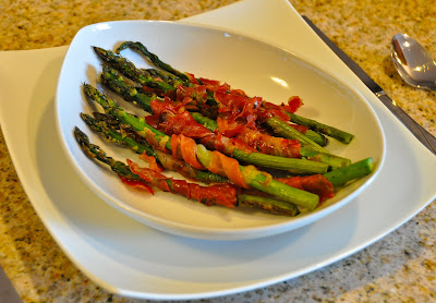 prosciutto wrapped around asparagus finished in bowl
