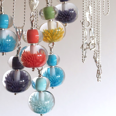 Lampwork glass 'Anemone' soft glass implosion bead necklaces by Laura Sparling