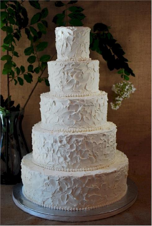 Roughed Up Ercream Wedding Cake
