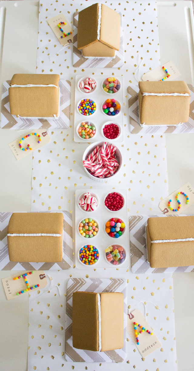 Beautiful Christmas party tablescape with holiday candy house building ingredients