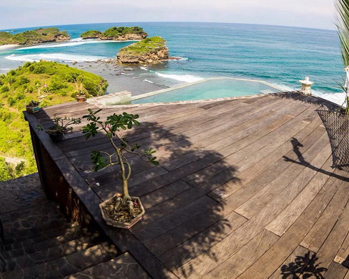 Tinuku Villa Batu Hill designed Joglo Javanese architecture perched on hilltop for view Watu Karung beach