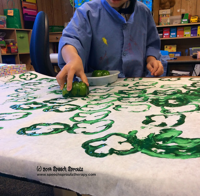 Stamping Shamrocks with a green pepper www.speechsproutstherapy.com