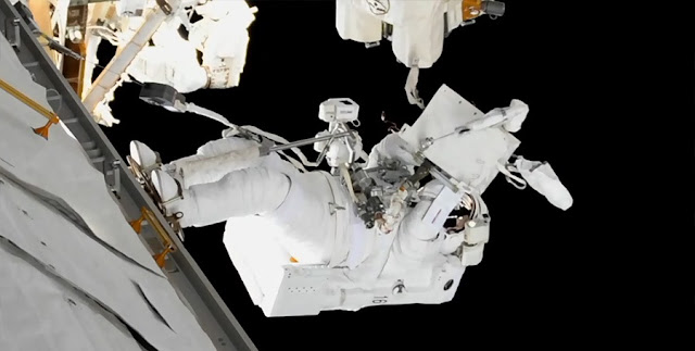 Mark Vande Hei works to lubricate the end effector of the robotic Canadarm2 during U.S. EVA-45. Photo Credit: NASA