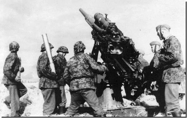 Waffen SS soldiers fire formidable German 88mm gun  tank-buster anti-aircraft gun.